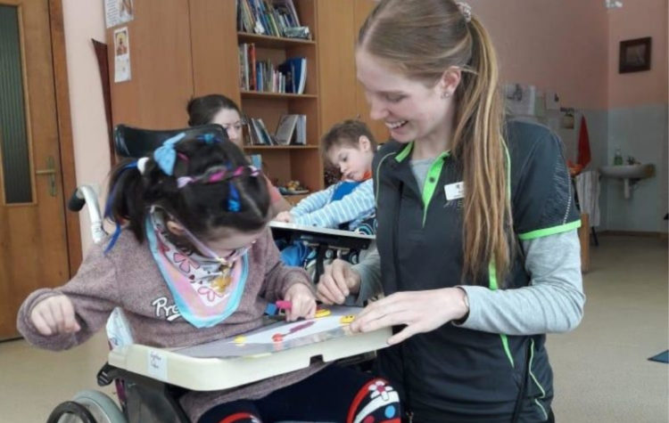Ukraine Speech Pathology Student with Child ukraine development together volunteers education health